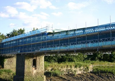 Hung scaffold under bridge inc walkways both sides by Hercules Scaffolding